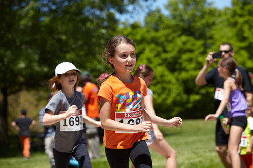 Event Photography of child running at Tim Hortons Run/Walk