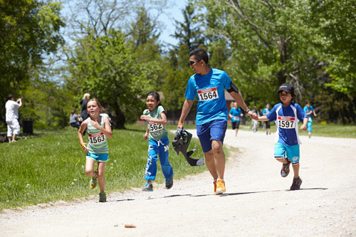 Event Photography of family running to finish at Tim Hortons Run/Walk