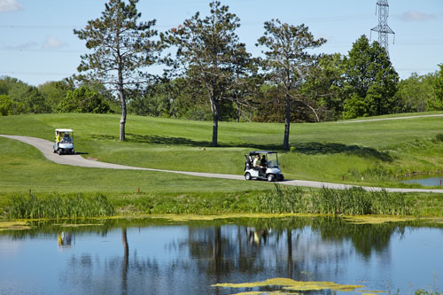 Event Photography for Tim Hortons golf tournament golf carts driving on course by Bochsler Photo imaging