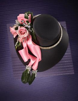 Flower Garland Photography for Annex Publishing pink flower on black hat Prom Corsage Arrangement