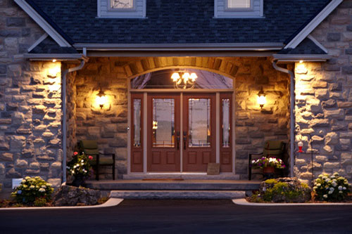 Residential Photography exterior stone wall with red front door Pollard Windows