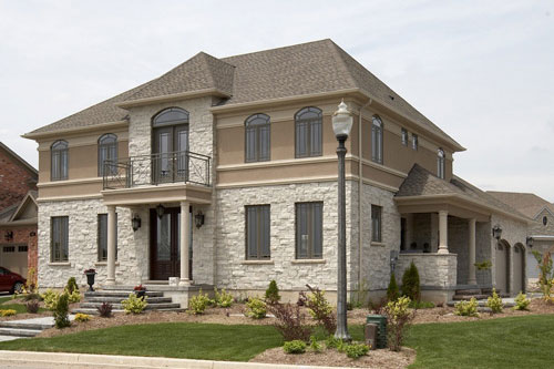 Residential Photography exterior stone and stucco Pollard Windows