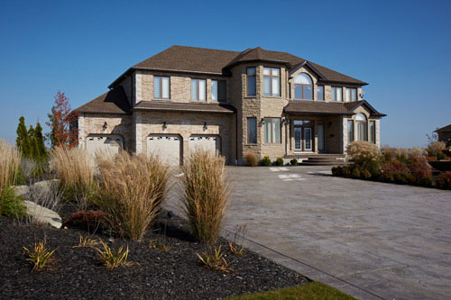 Residential Photography grey exterior and front lawn Pollard Windows Canada