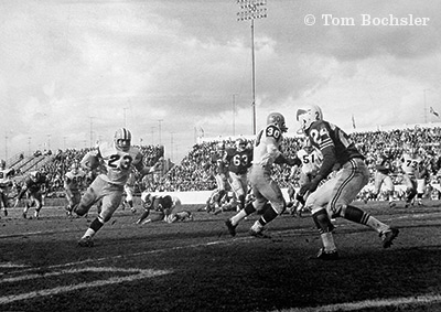 Tom Bochsler Art of Industry Hamilton Tiger Cats in action with Bobby Kuntz and Bob Jeter versus Montreal Alouettes 1962