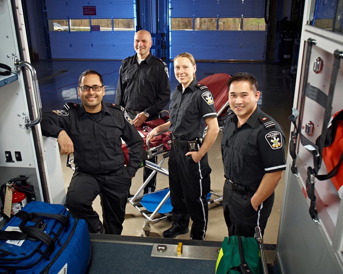 Group Portrait Photography Paramedic team outside vehicle