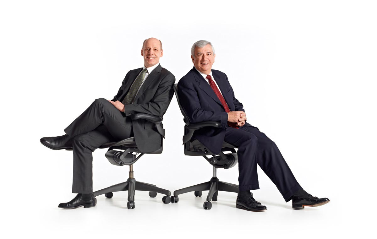 Group Portrait Photographer executive members on office chairs