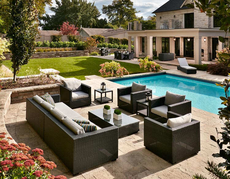 Costco Online patio furniture in backyard with pool and mansion
