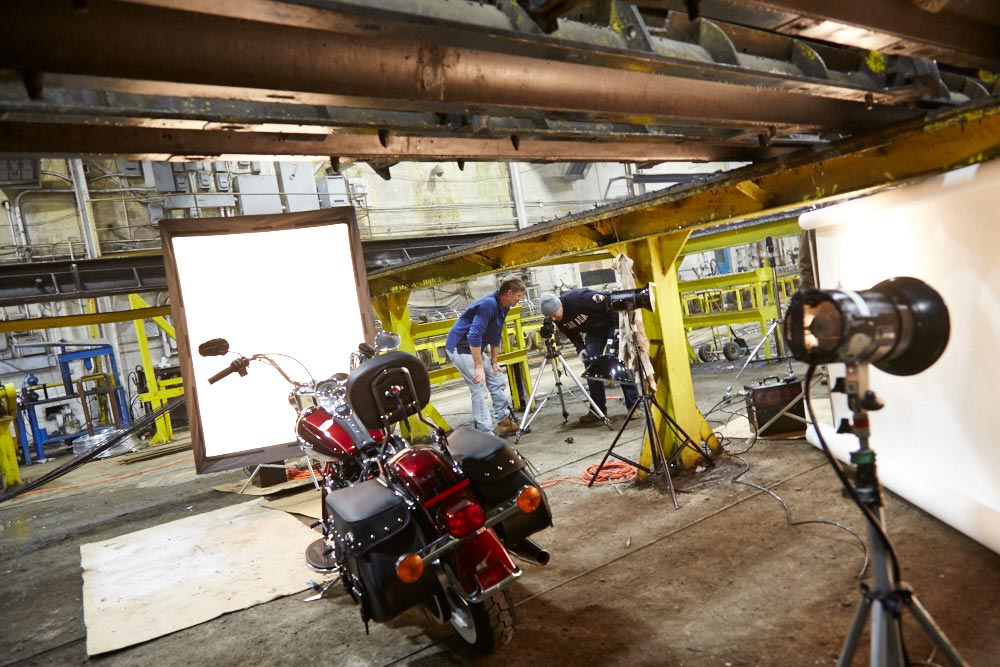 Harley Davidson behind the scenes in industrial building with John Lynch and John Majorossy