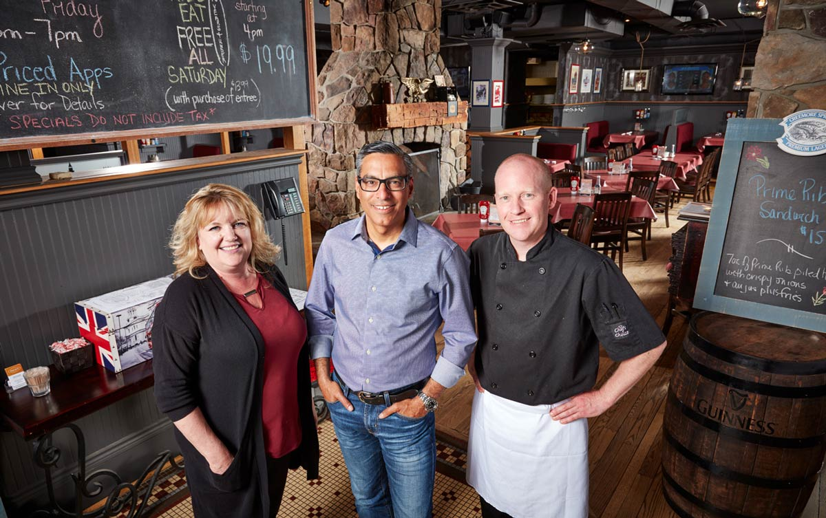 Portrait photography of restaurant owners group