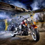 Illustrative Photo - Harley Davidson Red Motorcycle Black Saddle Bags Industrial Setting